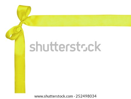 Corner for text, made of a yellow ribbon and a bow on the white - stock photo