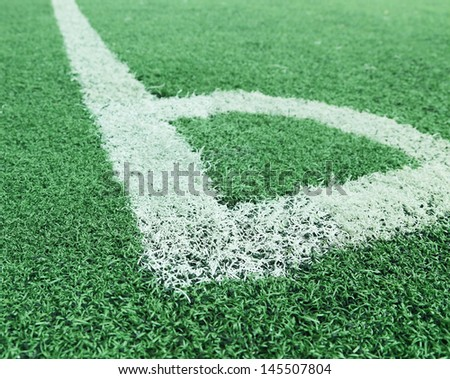 corner of a synthetic football field with white stripe - stock photo