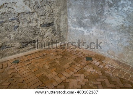 Corner of an old building without decoration and without people