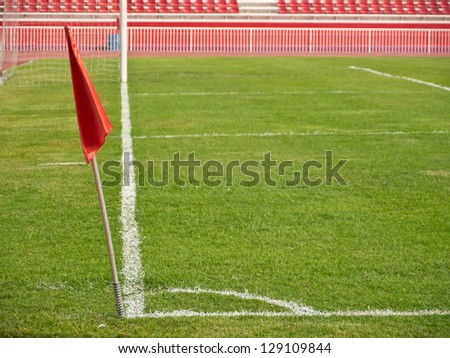 Corner of football field with red flag
