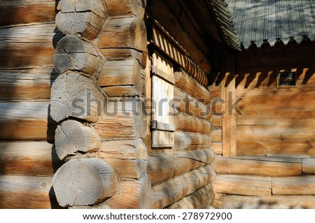 Corner of Russian old wooden house made of logs and the wooden part of the roof - stock photo