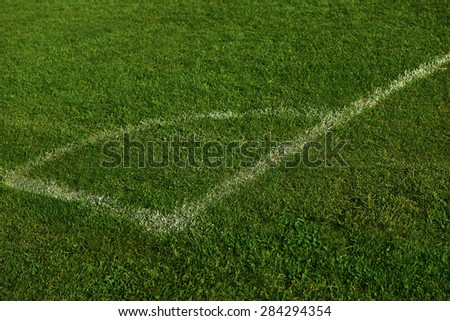 Corner of the soccer field green grass background