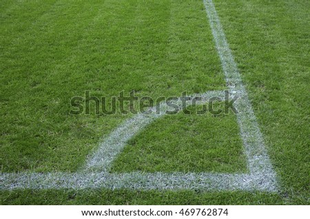 Corner of the soccer field with white markings