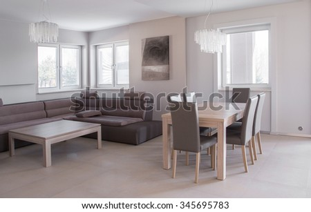 Corner sofa and dining table in beige exclusive interior