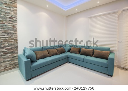 Corner sofa with cushions in luxury apartment living room