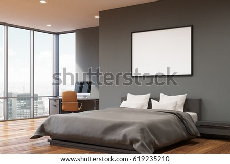 Corner View Of A Bedroom With Dark Gray Walls, A Double Bed With Two Pillows