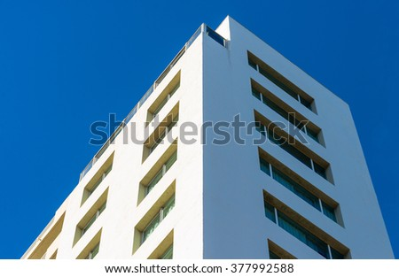 Corner view of an apartment building - stock photo