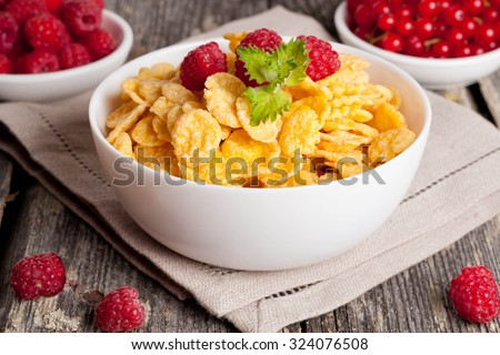 Cornflakes and different Berries, horizontal, close up - stock photo