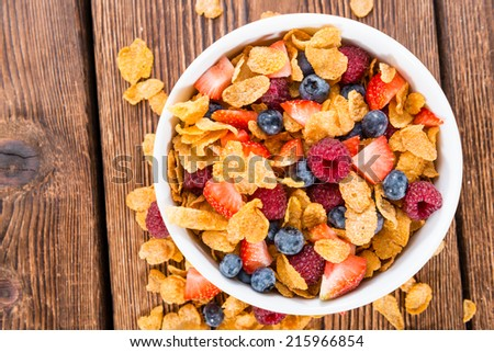 Cornflakes and different Berries (Strawberries, Blueberries and fresh Raspberries) - stock photo