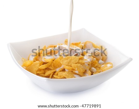 Cornflakes and pouring Milk - stock photo