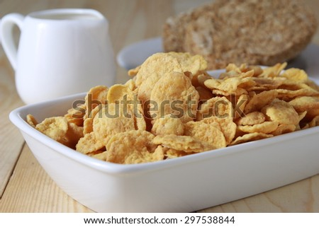 Cornflakes cereal and milk. Morning breakfast. - stock photo