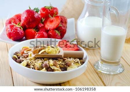 cornflakes, fruit in glass bowl and milk - stock photo