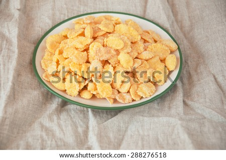 cornflakes in a bowl on textile background