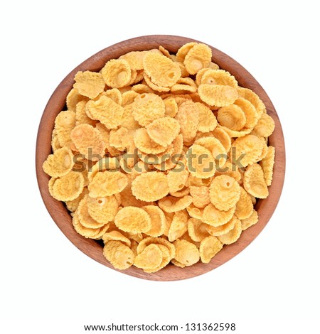 Cornflakes in a wooden bowl on a white background - stock photo