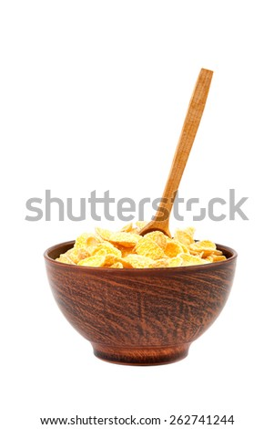 Cornflakes in bowl and wooden spoon isolated on white background. - stock photo