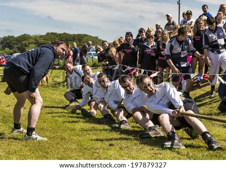 CORNHILL, ABERDEESNHIRE, SCOTLAND - 7 JUNE: This is a Tug of War Team within the Cornhill Highland Games, Aberdeenshire, Scotland on 7 June 2014.