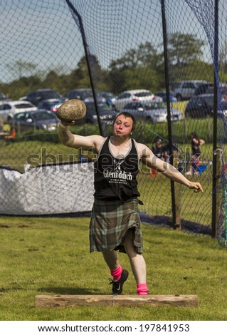 CORNHILL, ABERDEESNHIRE, SCOTLAND - 7 JUNE: This is throwing the heavy stone at the Cornhill Highland Games, Aberdeenshire, Scotland on 7 June 2014.