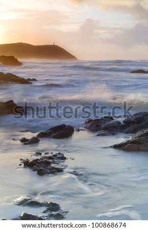 Cornish seascape shot at sunset. View to Stepper Point. - stock photo
