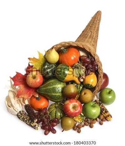 Cornucopia full of quash, pumpkins, and apples - stock photo
