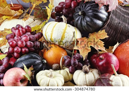 Cornucopia or Horn of Plenty with lots of fresh vegetables and fruit spilling out.  - stock photo