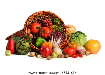 Cornucopia with fresh fruits and vegetables isolated over white background - stock photo