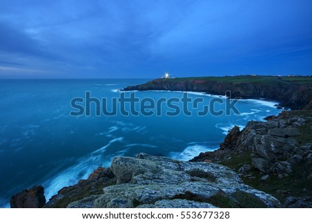 Cornwall, England. Aerial view of the sea near Lizard Point at dusk; beautiful lighthouse on background.