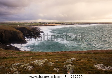Cornwall, England (United Kingdom): rocky coast during a storm.