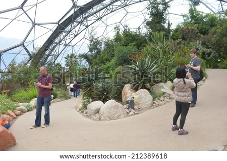 CORNWALL, UK - APRIL 20, 2014: The Eden Project in Cornwall consists of two artificial biomes that house plants collected from all around the world. - stock photo