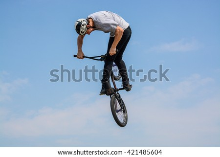 Cornwall, United Kingdom, May 16 2016, A Bmx biker performs a Turn Down, Bmx biking is a sport that has been popular in the UK with people of all ages since the late 70's and early 80's - stock photo
