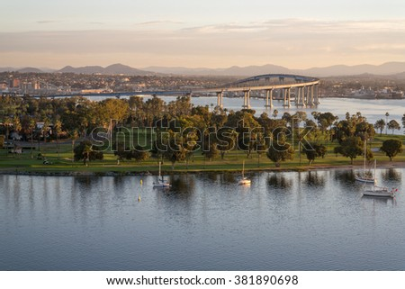 Coronado California dawn. Dawn arrives at Coronado Island revealing the bay, golf course, village and coronado bridge. - stock photo