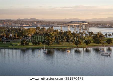 Coronado California dawn. Dawn arrives at Coronado Island revealing the bay, golf course, village and coronado bridge. - stock photo
