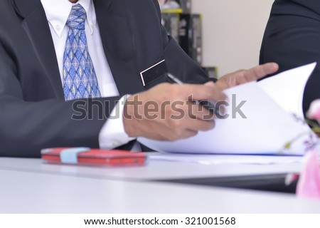 corperate meeting with document on hand