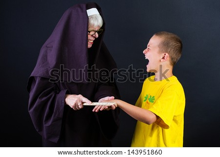 Corporal punishment by a nun - stock photo