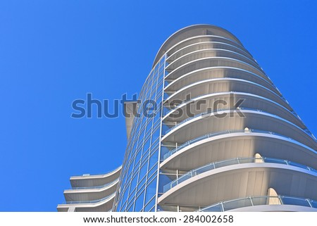 Corporate building and the cloudy sky - stock photo