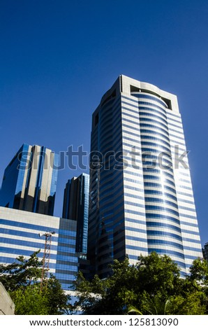Corporate buildings under blue skies. - stock photo