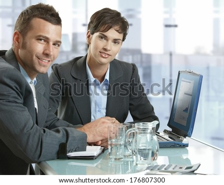 Corporate business people working at meeting table at office. - stock photo