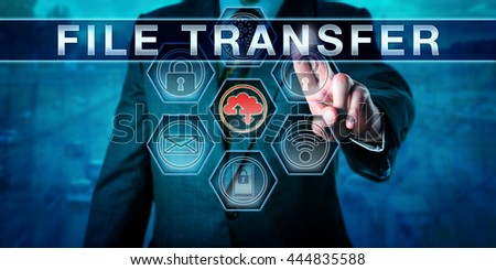 Corporate client is touching FILE TRANSFER on an interactive virtual  control monitor., internet terminology, business metaphor and information technology concept for secure network data transfer. - stock photo