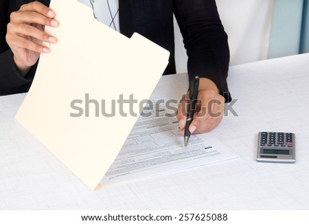 Corporate employee working of company accounts - stock photo