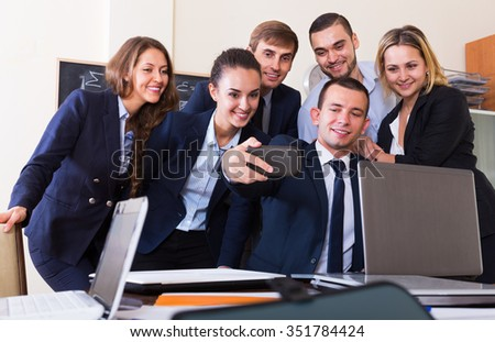 Corporate employees photoshooting together using the mobile phone  - stock photo