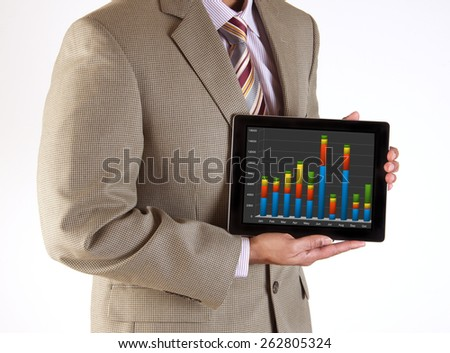 Corporate executive making a business presentation using mobile technology and tablet computer - stock photo