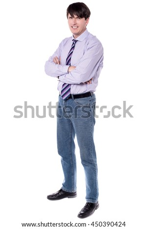 Corporate executive standing with folded arms.