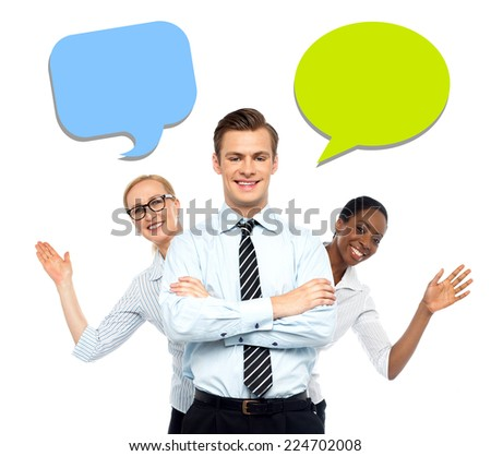 Corporate executive with team and speech bubble - stock photo