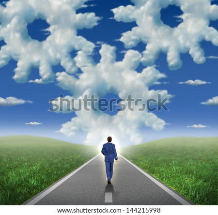 Corporate goals and horizon with a businessman walking as a leader towards a glowing sky with a group of clouds shaped as gear wheels and cogs as a symbol of business success and career planning. - stock photo