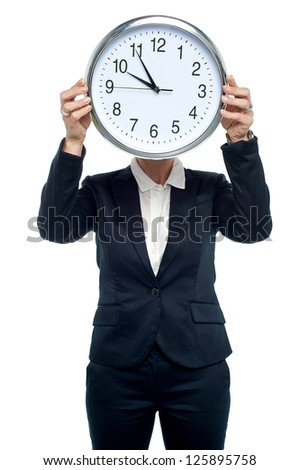 Corporate head hiding her face behind a wall clock, white background. - stock photo