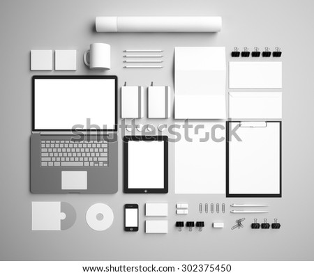 corporate identity Mock Up on a gray background. Set includes a laptop, a tube, a pencil, a tablet, a smartphone; icon; clip, business cards, pens, CD, flash card, paper clips, erasers, cup, sticker - stock photo