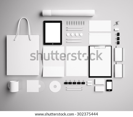 corporate identity Mock Up on a gray background. Set includes package, a tube, a pencil, a tablet, a smartphone; icon; clip, business cards, pens, CD, flash card, paper clips, erasers, cup, sticker - stock photo