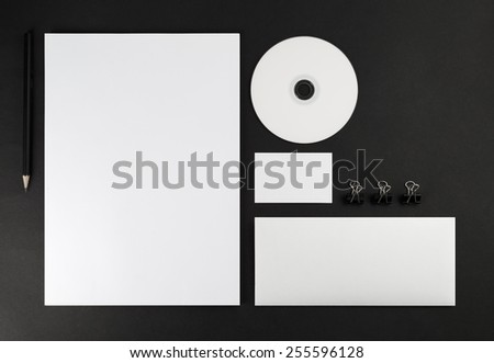 Corporate identity template on black background. Top view.
