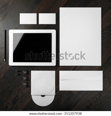 Corporate identity template on dark wooden background. For design presentations and portfolios. Top view.
