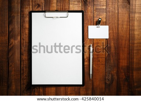 Corporate identity template on vintage wooden table background. Blank ID template. Blank letterhead, badge and pen. Branding template. Mock-up for design portfolios. Top view. - stock photo