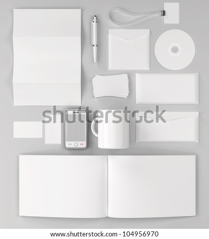 Corporate identity templates. Corporate identity templates:blank, business cards, disk, envelope, smart phone, pen, badge, cup, brand-book. Isolated with soft shadows - stock photo